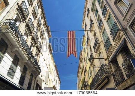 Flag of Catalonia on the street of Perpignan. France.