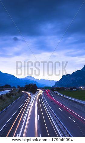 Night Highway. Mountainous landscape. Central Switzerland Gotthard Strasse.