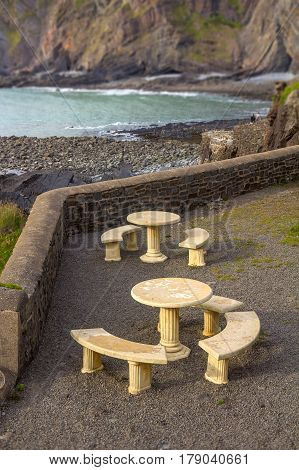 Tables of the cafe on the street in the picturesque place of Hartland Quay. Devonshire. England