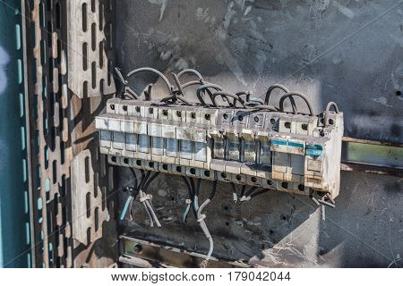 Deteriorate and dusty circuit breaker in a disused hangar