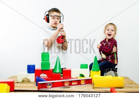 A group of children with construction tools, isolate of white background.