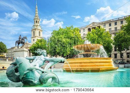 View of the fountains in the Trafalgar square on a bright summer day