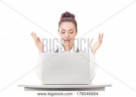 Confused businesswoman at work with laptop shrugging shoulders over white isolated background. Woman in question gesture looking at pc screen