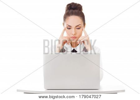 Serious hard thinking business woman busy working on laptop at work looking at pc screen. Beautiful businesswoman being concentrated.
