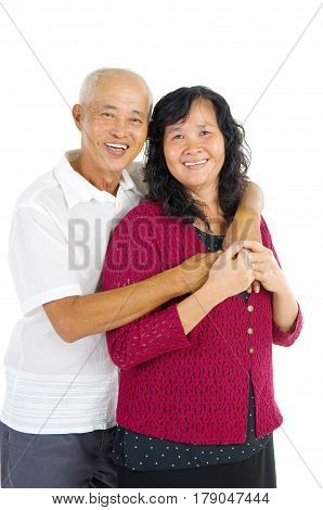 Happy senior aged Asian couple in love. Asian senior couple smiling isolated on white background.