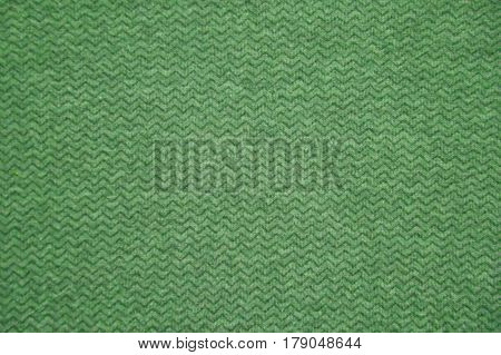 Green fabric texture. Green cloth background. Close up view of green fabric texture and background. Abstract background and texture for designers. Green cloth pattern