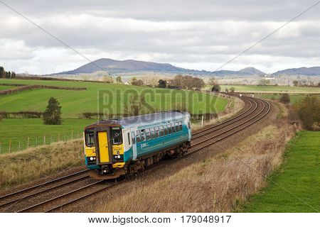 CRAVEN ARMS, UK - MARCH 13: An Arriva Trains operated stopper service heads toward South Wales on March 13, 2017 in Craven Arms. Arriva operate 244 stations over a distance of 1671 Km of the network.