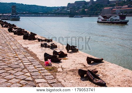 Shoes on the Danube, famous holocaust memorial in Budapest .Monument, which represents the shoes of the victims left behind on the bank, Budapest, Hungary