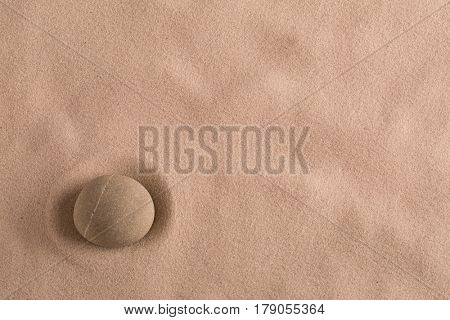 zen stone minimal background for yoga, meditation or relaxation. Meditation rock in sand with copy space.