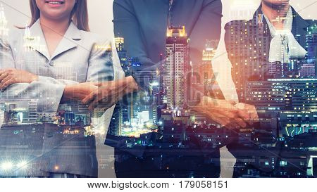 Double Exposure three businesswoman join handsBusiness concept