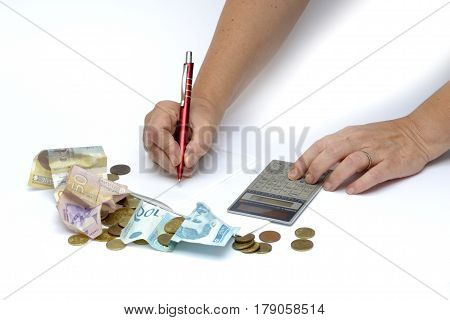 Person counting money and account expensive life costs