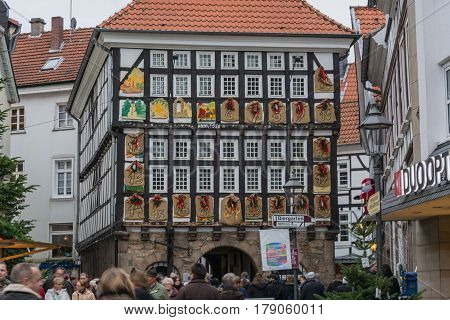HATINGEN NRW GERMANY - DECEMBER 6 2015: People at the Christmas market in Hattingen in the background an old half-timbered house with giant Advent calendar.