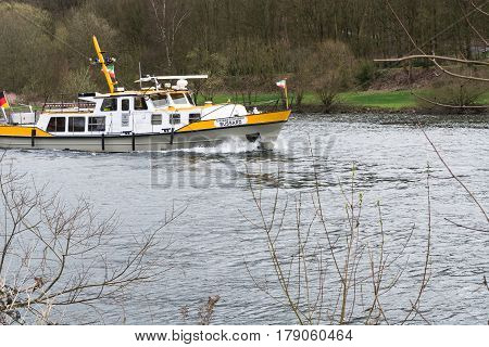 ESSEN NRW GERMANY - APRIL 4 2016: River supervisor boat Bussard MS at a check ride on the river Ruhr in Germany. Boat in use for water protection.