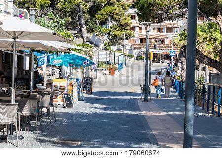 SANT ELM MALLORCA SPAIN - JUNE 04 2016: Sant Elm City quaint shopping street in the small town of San Telmo Mallorca Spain.