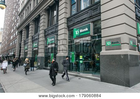 New York March 11 2017: People walk by a TD Bank branch in Manhattan.