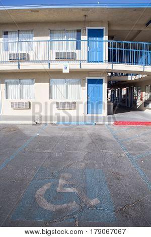 old Handicapped parking spot infront of motel room