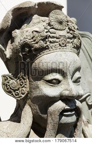 Close up of an asian statue in the buddhist temple Wat Pho in Bangkok; Thailand