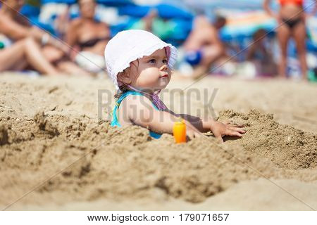 Happy child girl playing in clear clean sea water