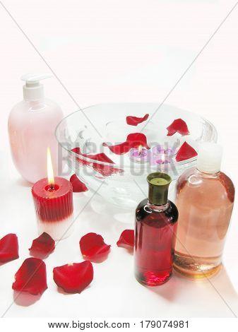 spa bowl with rose petals enssences bottles and liquid soap
