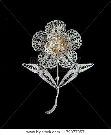 Vintage filigree silver brooch Flower isolated on black background