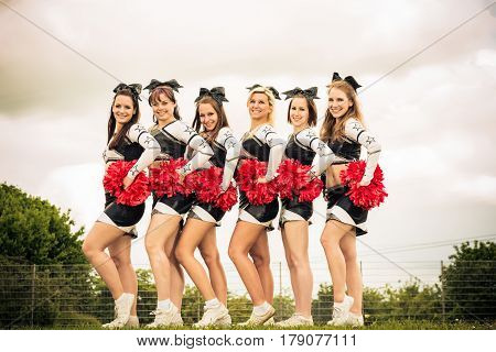 Outdoors shot of cheerleaders rooting for their team