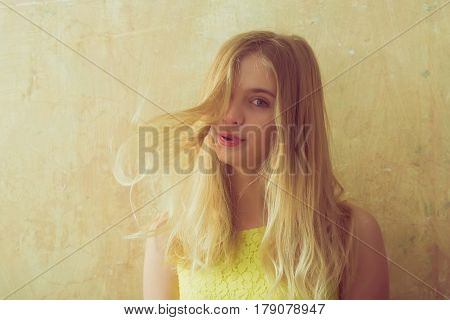 Pretty Happy Girl With Long Blonde Hair In Yellow Dress