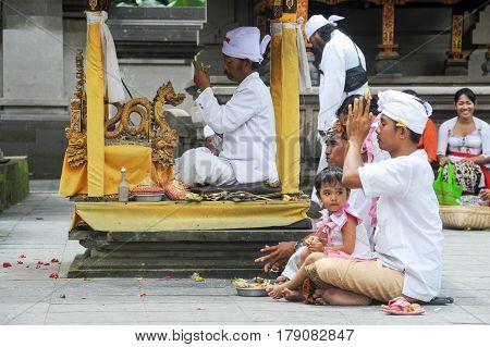 People Praying At Tirta Empul Hindu Temple Of Bali On Indonesia