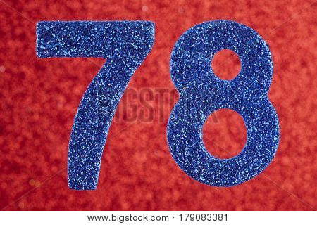 Number seventy-eight blue color over a red background. Anniversary. Birthday