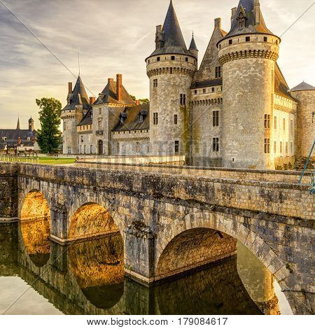 The chateau of Sully-sur-Loire at suset, France. This castle is located in the Loire Valley dates from the 14th century and is a prime example of medieval fortress.