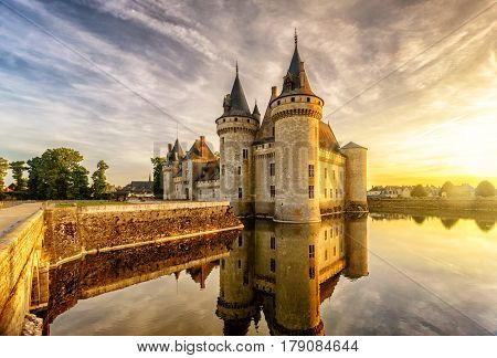 The chateau of Sully-sur-Loire at sunset, France. This castle is located in the Loire Valley dates from the 14th century and is a prime example of medieval fortress.