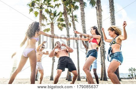 Multi-ethic group of people having fun on the beach