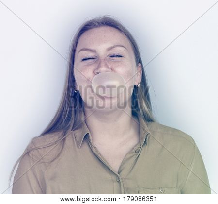 Caucasian Woman Blowing Bubble Gum Studio