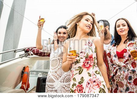 Group of friends making party on a yacht in Dubai - Happy people having a fancy party on a luxury boat