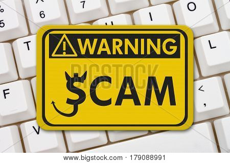 Scam alert warning sign A yellow warning sign with text Scam Alert and dollar devil icon on a keyboard 3D Illustration