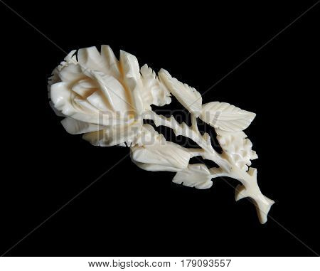 Antique Ivory carved brooch Rose isolated on black background