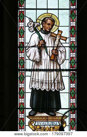 KRATECKO, CROATIA - JULY 16: Saint Aloysius stained glass window in Parish Church of Saint Roch in Kratecko, Croatia on July 16, 2010.