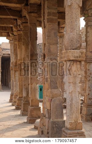 DELHI, INDIA - FEBRUARY 13: Columns with stone carving in courtyard of Quwwat-Ul-Islam mosque, Qutab Minar complex, Delhi, India on February 13, 2016.