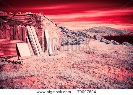 an infrared shot of an old hut with the mediterranean sea in the background. this photo was taken with a modified, infrared-capable DSLR.