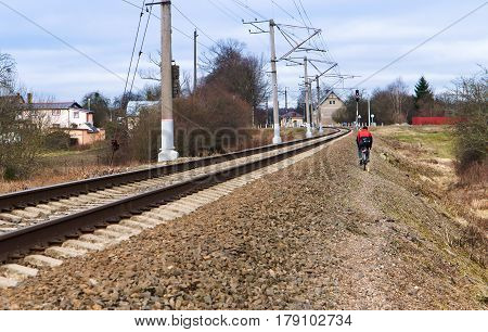 to go with the bike along the railway tracks on the mound