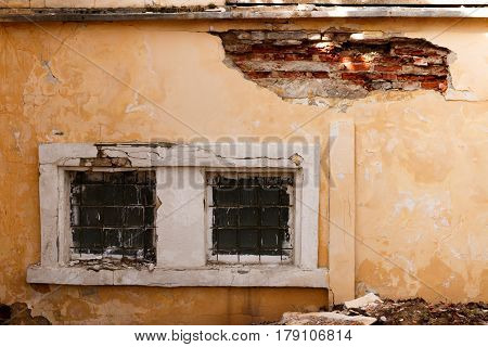 Two Broken Windows Of The Old Abandoned Brick Building