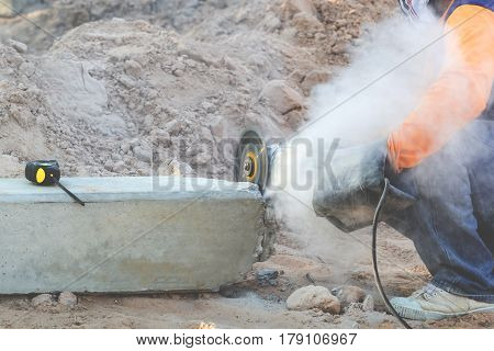 The mechanic is using concrete mortar. Cause dustiness while cutting And on the concrete pillars there are cartridges mounted on concrete pillars.