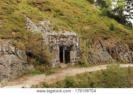 Bunker built in the rock with a small footpath