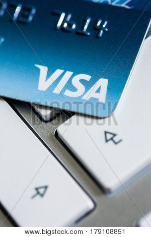 Benon, France - Feb 08, 2017: Visa Credit Card On The Keyboard, Close Up Photo