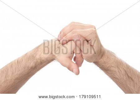 Hands of young man suffering from pain in joints on white background