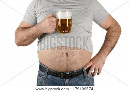 Man with big belly holding glass of beer on white background