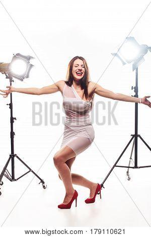 Happy Brunette Girl In Studio