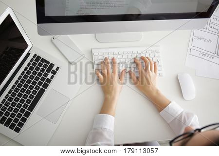Woman programmer working at office