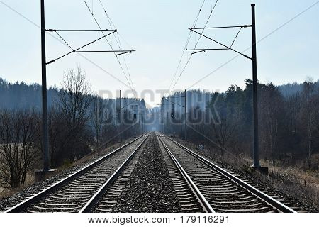 Traction power line rail corridor. Railroad tracks. In the distance tunnel. Railways.