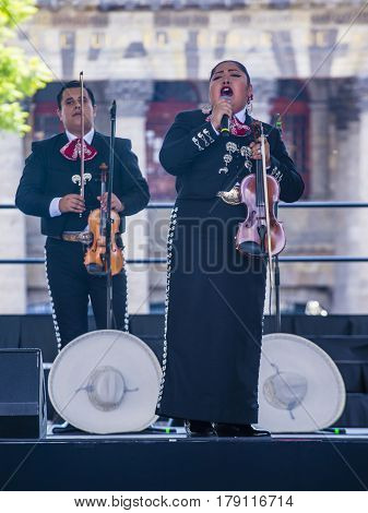 GUADALAJARA MEXICO - AUG 28 : Mariachis perform on stage at the 23rd International Mariachi & Charros festival in Guadalajara Mexico on August 28 2016.