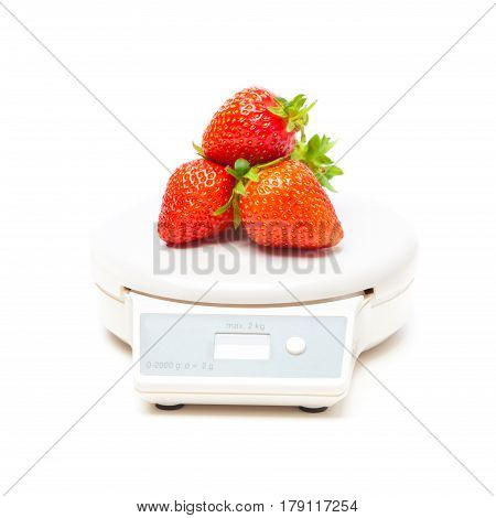 white kitchen scale with strawberries, isolated on white